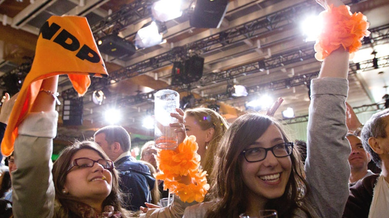 New Democratic Party supporters cheer as they watch results at NDP leader Jack Layton's election event in Toronto on Monday, May 2, 2011. (Chris Young / THE CANADIAN PRESS)
