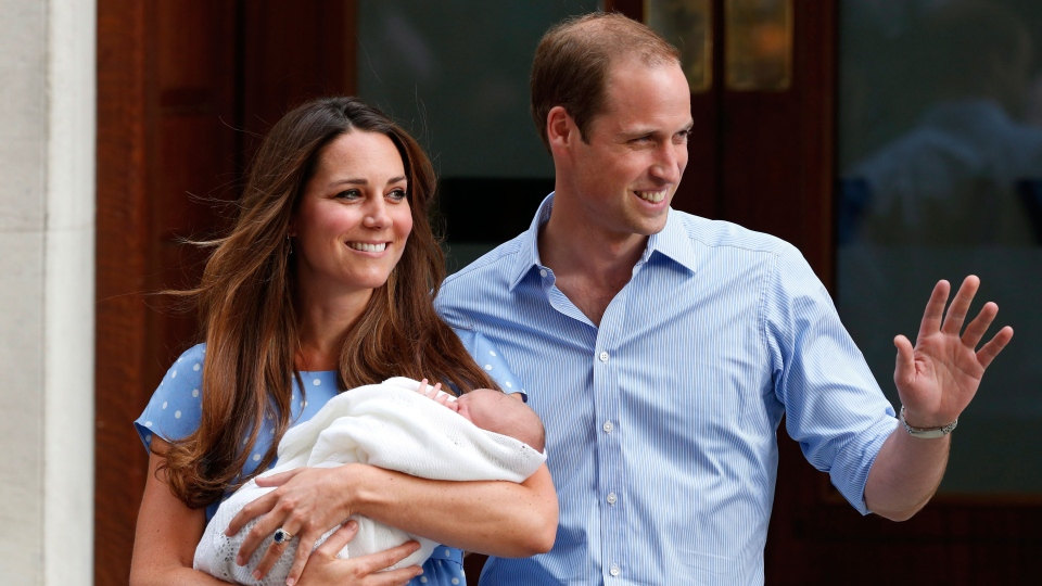 Prince William and Kate, Duchess of Cambridge hold the Prince of Cambridge, as they pose for photographers outside St. Mary's Hospital exclusive Lindo Wing in London, Tuesday, July 23, 2013. (AP / Lefteris Pitarakis)