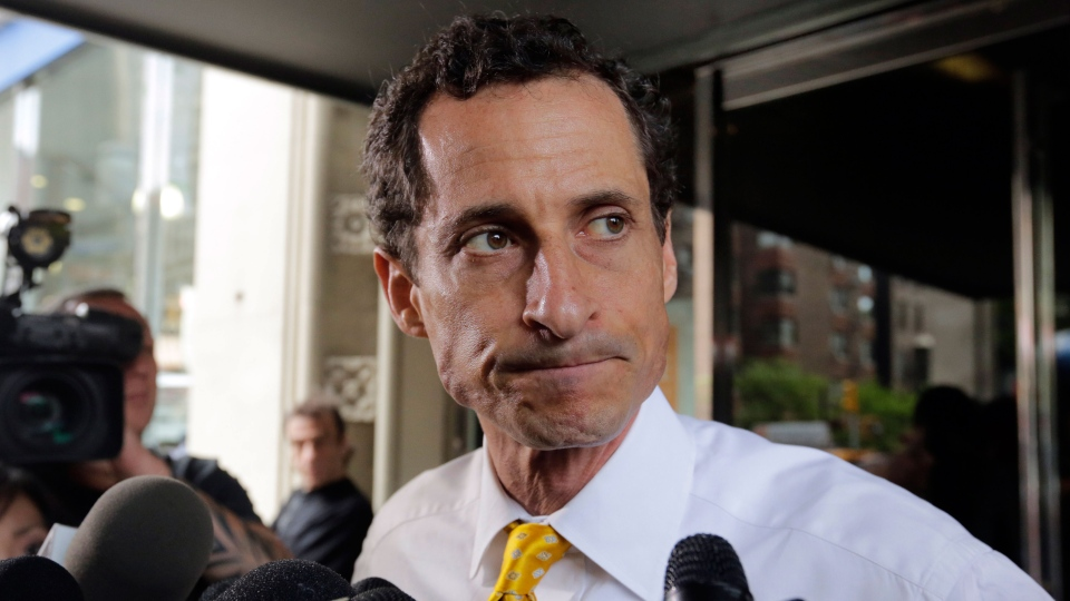 New York City mayoral candidate Anthony Weiner leaves his apartment building in New York on Wednesday, July 24, 2013. (AP / Richard Drew)