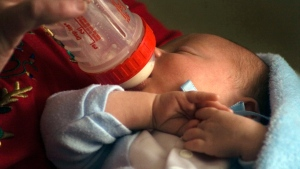 An infant drinks from a bottle in this 2011 file photo. (AP Photo/James B. Hale)
