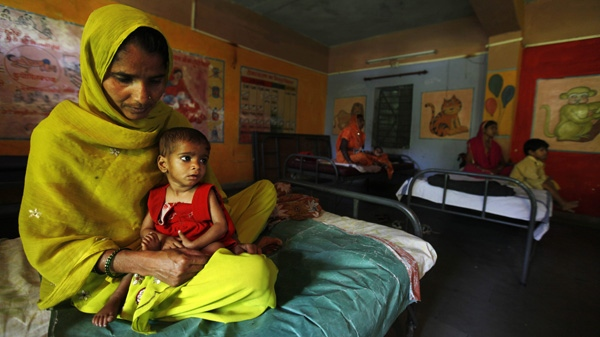 In this photo taken Wednesday, April 13, 2011, Shakila sits with her malnourished daughter Sania at a ward for malnourished children, where nine out of ten children are girls, at a government hospital in Morena in the Central Indian State of Madhya Pradesh. (AP Photo/Mustafa Quraishi)