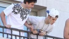 Justin Bieber spits off balcony