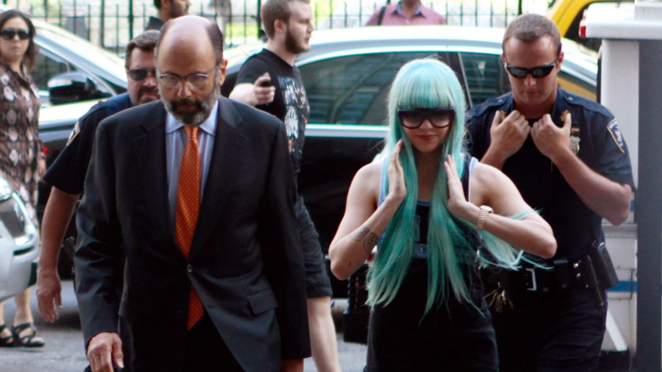 Amanda Bynes, accompanied by attorney Gerald Shargel, arrives for a court appearance in New York, Tuesday, July 9, 2013. (AP / Bethan McKernan)