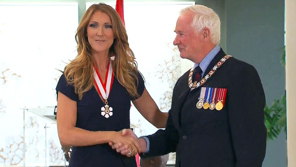 Celine Dion shakes Gov.-Gen. David Johnston's hand after being presented with the insignia that officially names her as a Companion of the Order of Canada, in Quebec City, Friday, July 26, 2013.