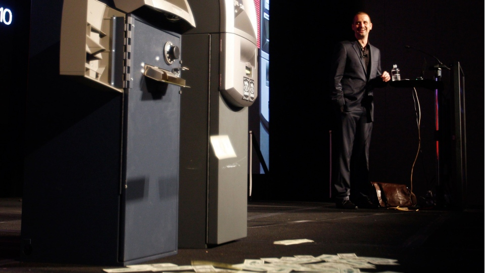 Barnaby Jack demonstrates an attack on two automated teller machines during the Black Hat technology conference in Las Vegas on Wednesday, July 28, 2010. (AP / Isaac Brekken)