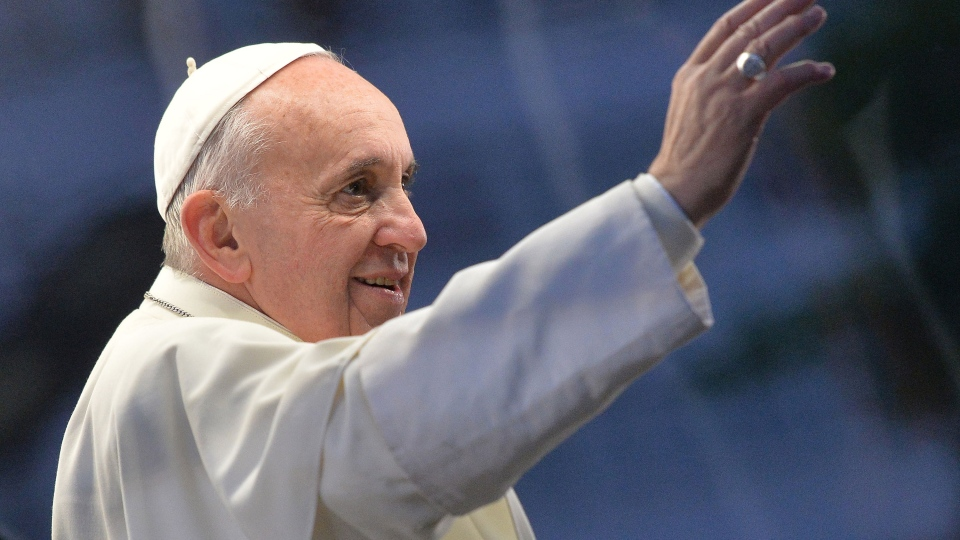 Pope Francis waves to pilgrims as he attends the Stations of the Cross service on the Copacabana beachfront in Rio de Janeiro, Brazil, Friday, July 26, 2013. (AP / Luca Zennaro)