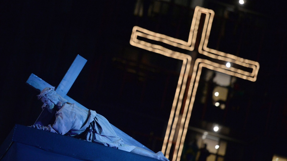 An actor plays the role of Jesus Christ during the Stations of the Cross service, on the Copacabana beachfront in Rio de Janeiro, Brazil, Friday, July 26, 2013. (AP / Luca Zennaro)