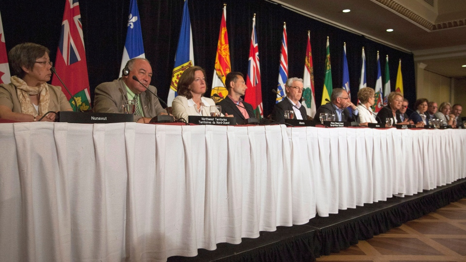 Premiers (from left) Eva Aariak, Bob McLeod, Alison Redford, Robert Ghiz, Greg Selinger, Darrell Dexter, Kathleen Wynne, Pauline Marois, David Alward, Christy Clark, Brad Wall, Kathy Dunderdale, and Darrell Pasloski take part in the closing news conference on the final day of the Council of the Federation summer meeting in Niagara-on-the-Lake, Ont., Friday, July 26, 2013. (Aaron Lynett / THE CANADIAN PRESS)