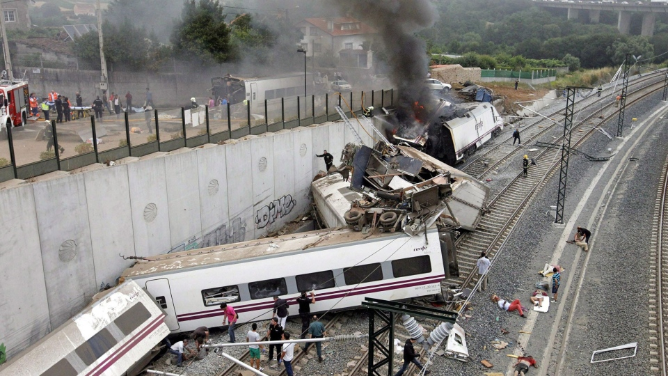 Emergency personnel respond to the scene of a train derailment in Santiago de Compostela, Spain, Wednesday, July 24, 2013. (La Voz de Galicia / Monica Ferreiros)