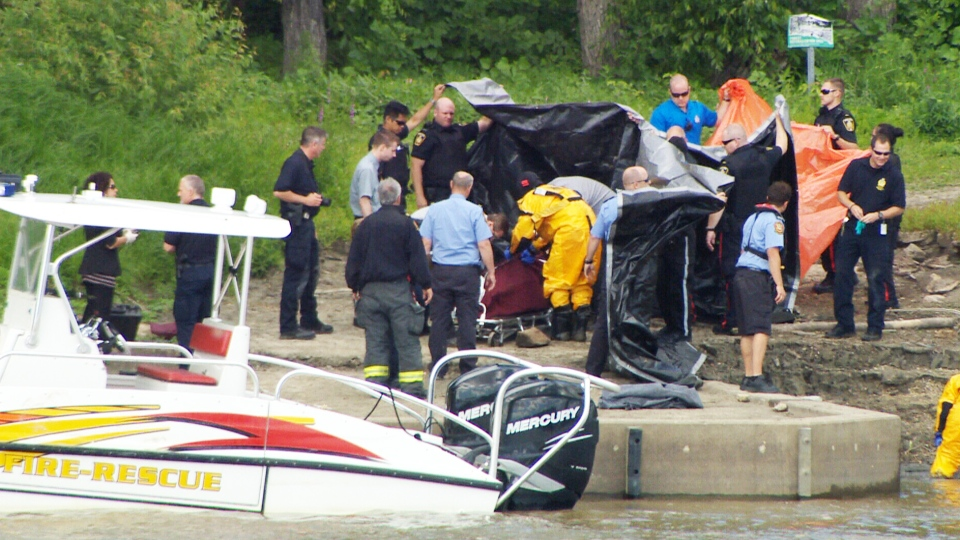 Police officers found a body in the Red River in Winnipeg, Saturday, July 27, 2013.