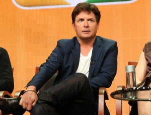 Michael J. Fox is shown in this publicity photo during a panel in Beverly Hills, Calif., on July 27, 2013. In his upcoming NBC comedy, Fox will star as Mike Henry, a former newscaster with Parkinson's. (NBC/Chris Haston)