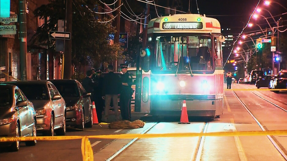 Police investigate the scene of a shooting on a Dundas streetcar near Trinity Bellwoods Park on Saturday, July 27, 2013.