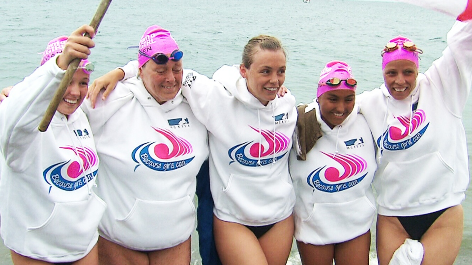 A five-woman relay team poses for a photo after coming out of the water in Whitby, Ont.