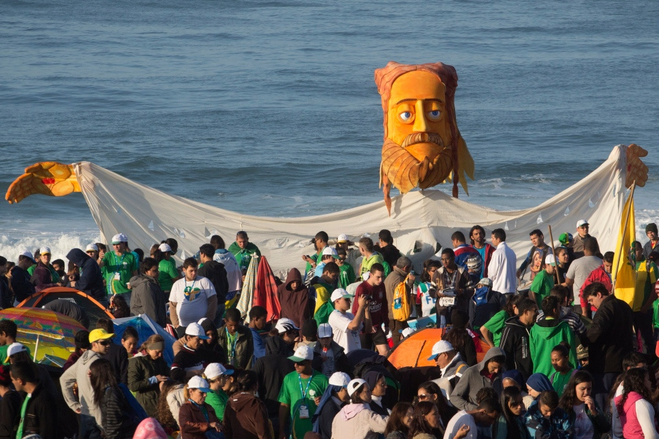 Pilgrims carry a large puppet representing Jesus as they wait for Pope Francis' arrival on Copacabana beach in Rio de Janeiro, Brazil, Sunday, July 28, 2013. (AP / Victor R. Caivano)
