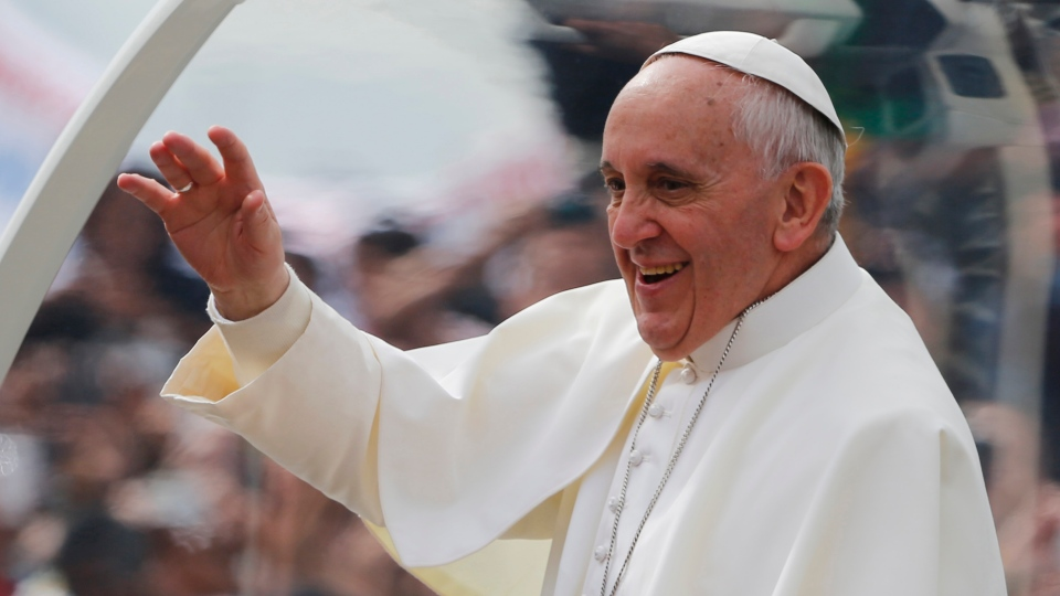 Pope Francis waves from his popemobile