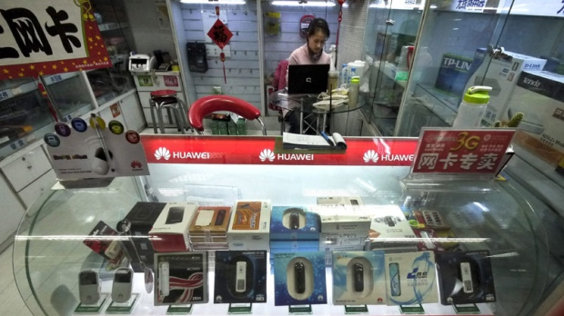 A vendor works at a store selling Huawei network devices at a computer mall in Beijing, China Thursday, Feb. 17, 2011. (AP Photo/Andy Wong)