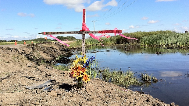 The father of 15-year-old Tarren Attfield, Dalbert, placed a wooden cross at the scene of a tragic collision that took the life of his son and five other teens.