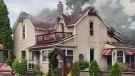 Firefighters battle a blaze at a home in Rodney, Ont. on Sunday, July 28, 2013.