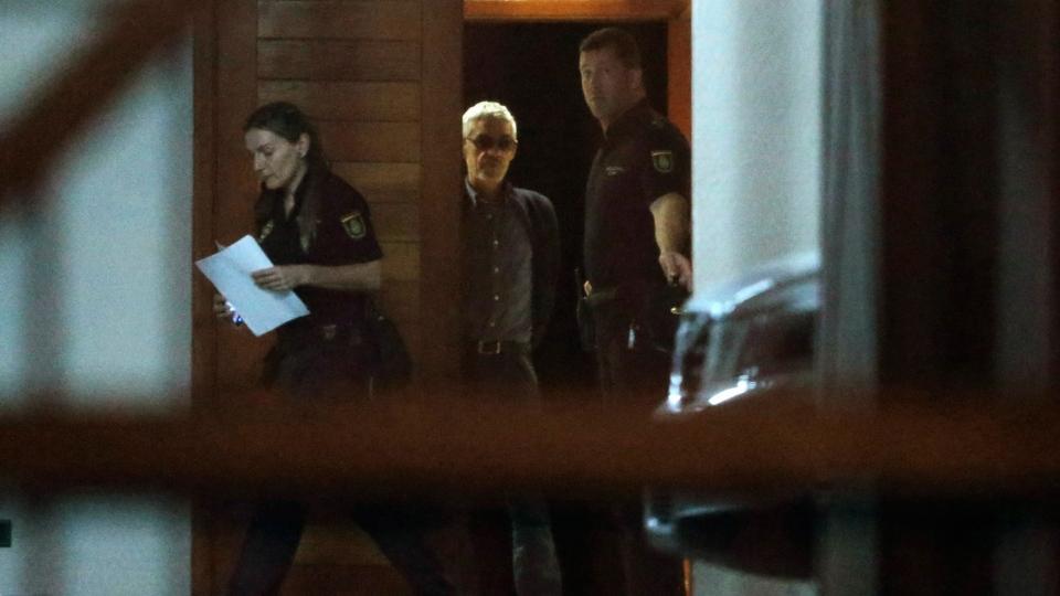 Police stand guard as train driver Francisco Jose Garzon Amo, centre, leaves the court following his release in Santiago de Compostela, Spain, Sunday, July 28, 2013. (AP / Lalo R. Villar)