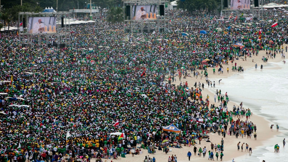 Crowds attending the World Youth Day's closing Mass line the shore of Copacabana beach in Rio de Janeiro, Sunday, July 28, 2013. (AP / Domenico Stinellis)