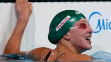 Meilutyte sets record at Swim World's prelims
