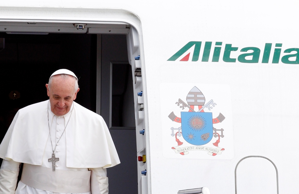Pope Francis disembarks from the plane after landing from Rio de Janeiro, Brazil, at Ciampino's military airport, on the outskirts of Rome, Monday, July 29, 2013. (AP / Riccardo De Luca)