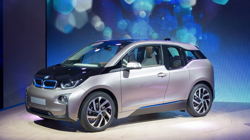 In this photo provided by BMW, the new four-seat electric BMW i3 is shown, Sunday, July 28, 2013 in New York. BMW's new electric has a lightweight carbon fiber reinforced plastic body and can travel 80 to 100 miles between charging. (AP / Tom Kirkpatrick, BMW)