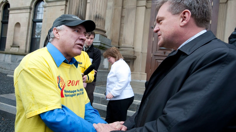 Tim Donovan, president of the New Hope for Multiple Sclerosis Cross Canada Tour, talks to New Brunswick Premier David Alward at the tour's launch at the legislature in Fredericton on Thursday, May 5, 2011. (David Smith / THE CANADIAN PRESS)