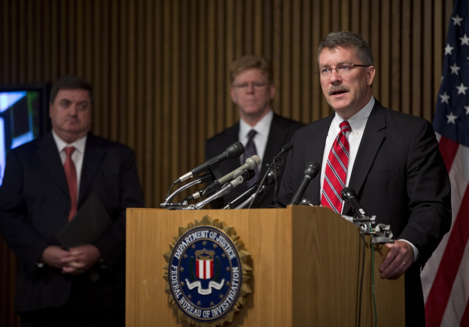 "Ron Hosko, assistant director of the FBI's Criminal Investigative Division, right, speaks during a news conference at FBI headquarters in Washingotn, Monday, July 29, 2013, about ""Operation Cross Country."" AP Photo/Evan Vucci)"
