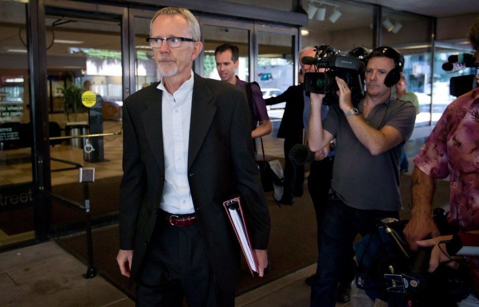 Defence lawyer Peter Wilson, left, leaves B.C. Supreme Court after his client, RCMP Const. Bill Bentley was found not guilty of lying at the public inquiry into the death of Polish immigrant Robert Dziekanski, in Vancouver, B.C., on Monday July 29, 2013. (Darryl Dyck / THE CANADIAN PRESS)