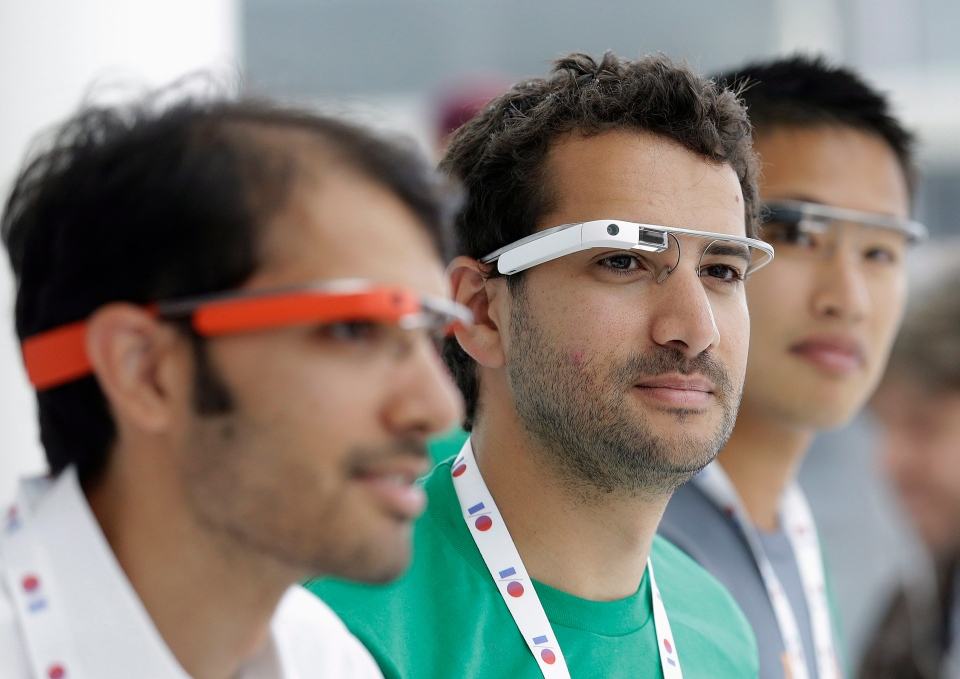 Google Glass team members wear Google Glasses at a booth at Google I/O 2013 in San Francisco, Wednesday, May 15, 2013. (AP / Jeff Chiu)