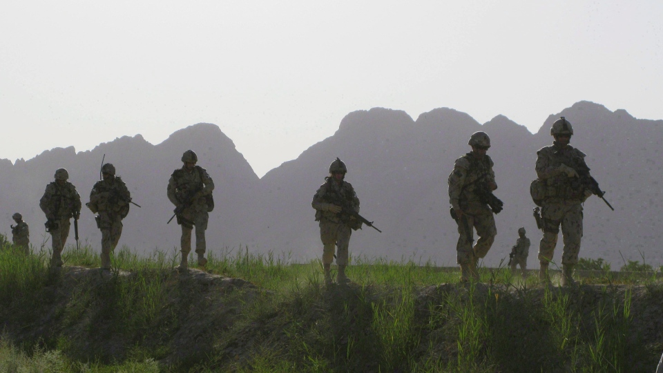 Canadian soldiers patrol an area in the Dand district of southern Afghanistan on Sunday, June 7, 2009. (Colin Perkel / THE CANADIAN PRESS)