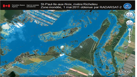 Satellite imagery from the Canadian Space Agency shows the extent of the flooding in Saint-Paul-de-l'Ile-aux-Noix. (Courtesy Canadian Space Agency).