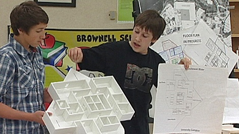 Lucas Garvin showed his classmates some of his ideas on his detailed floor plan.
