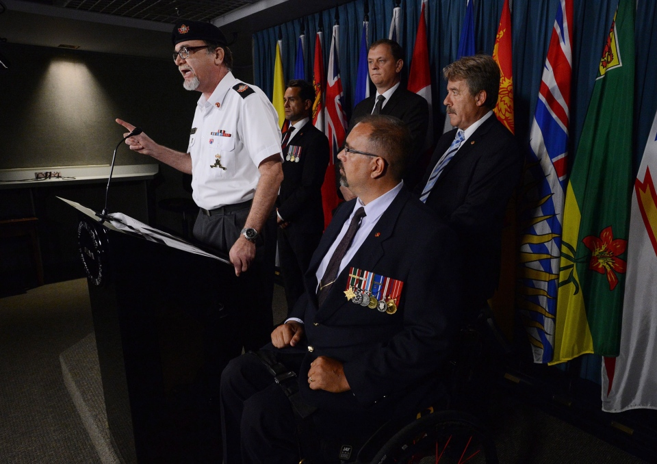 Veteran Michael Blais, President and founder of Canadian Veterans Advocacy, clockwise from left, Veteran Carlos Robert Steiner, NDP Deputy Veterans Affairs Critic Sylvain Chicoine, NDP Veterans Affairs Critic Peter Stoffer and Veteran David Desjardins take part in a press conference on Parliament Hill in Ottawa on Tuesday, July 30, 2013. (Sean Kilpatrick / THE CANADIAN PRESS)