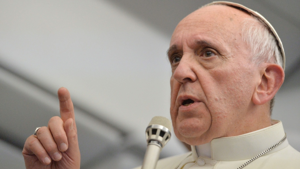 Pope Francis answers reporters' questions during a news conference aboard the papal flight on the journey back from Brazil, Monday, July 29, 2013. (AP / Luca Zennaro, Pool)