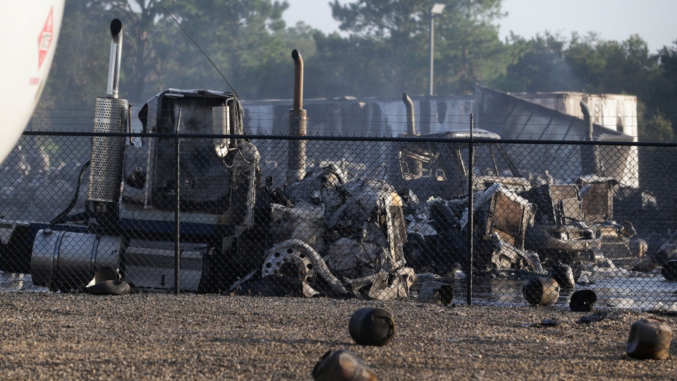 The remains of several burned and melted trucks are seen after an explosion at a propane gas company Tuesday, July 30, 2013, in Tavares, Fla. (AP /John Raoux)