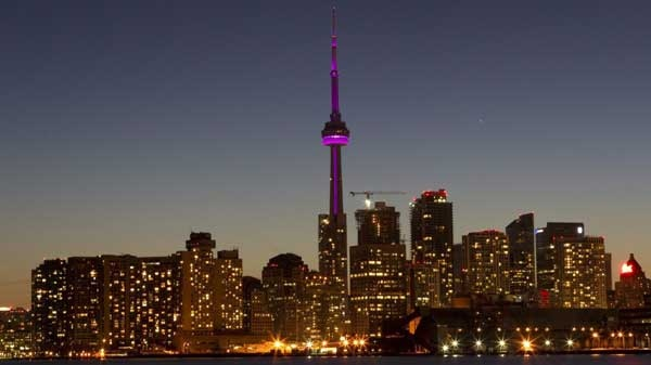 The Toronto city skyline is pictured moments before the start of Earth Hour on Saturday March 26, 2011. Buildings and homes across the country are going dark as Canadians take part in the fifth annual Earth Hour. (Chris Young / THE CANADIAN PRESS)