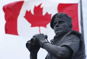 The Canadian Flag flies over the Peacekeeping memorial in Ottawa Tuesday May 29, 2012. (Adrian Wyld / THE CANADIAN PRESS)