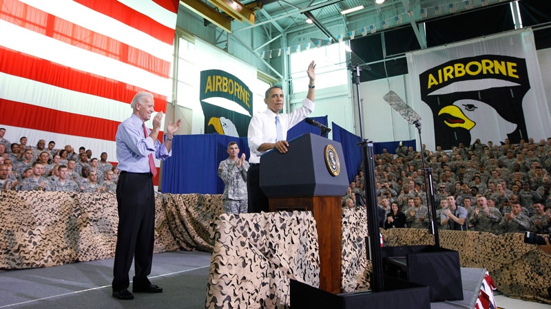 President Barack Obama, right, and Vice President Joe Biden rally military personnel at Fort Campbell, Ky., who have recently returned from Afghanistan after speaking about the mission that resulted in the death of Osama bin Laden, Friday, May 6, 2011. (AP / Charles Dharapak)