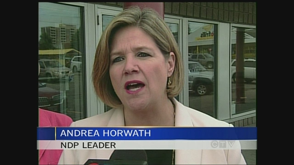 Ontario NDP Leader Andrea Horwath campaigns ahead of a byelection in London, Ont. on Wednesday, July 31, 2013.