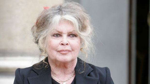 Former actress and now animals rights activist Brigitte Bardot smiles after a meeting on the environment with French President Nicolas Sarkozy, unseen, at the Elysee Palace in Paris, Thursday, Sept. 27, 2007. (AP / Jacques Brinon)
