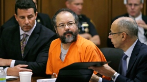 Ariel Castro, centre, listens in the courtroom during the sentencing phase in Cleveland, Thursday, Aug. 1, 2013. (AP / Tony Dejak)