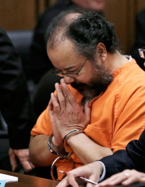 Ariel Castro rubs his nose in the courtroom during the sentencing phase Thursday, Aug. 1, 2013, in Cleveland. (AP / Tony Dejak)
