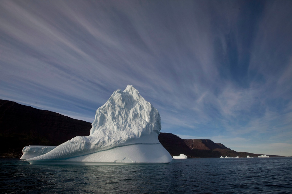 An iceberg floats in the sea near Qeqertarsuaq, Disko Island, Greenland in this 2011 file photo. (AP Photo/Brennan Linsley)