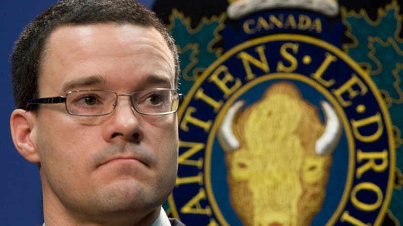 RCMP Insp. Tim Shields pauses for a moment as he takes questions during a news conference at RCMP headquarters in Vancouver, Tuesday, Jan. 13, 2009. (Jonathan Hayward / THE CANADIAN PRESS)