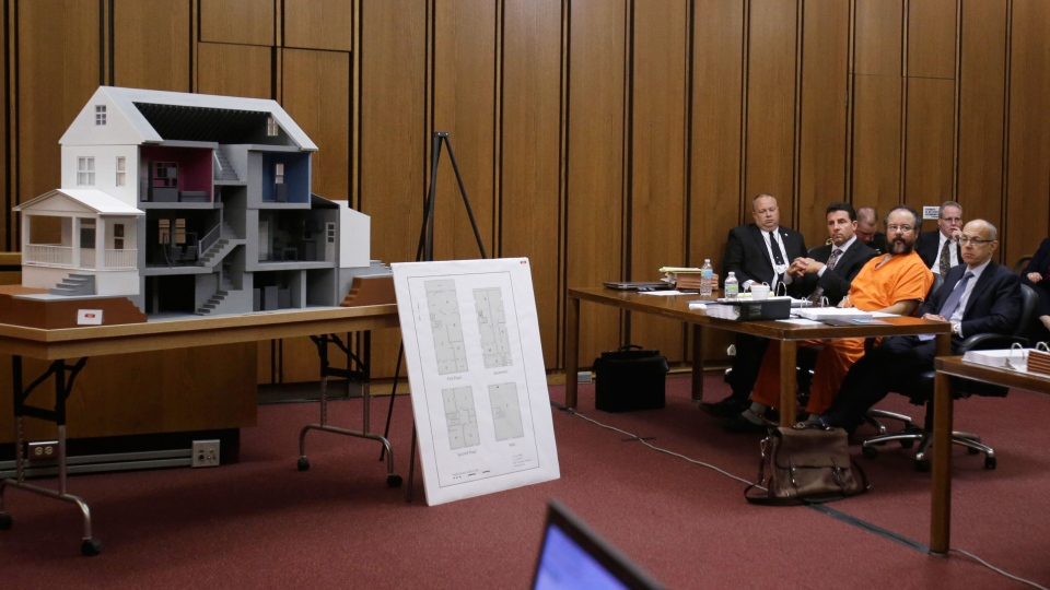 Ariel Castro sits close to a model of the house on Seymour Ave. , where three women were held in the courtroom during the sentencing phase in Cleveland on Thursday, Aug. 1, 2013. (AP / Tony Dejak)