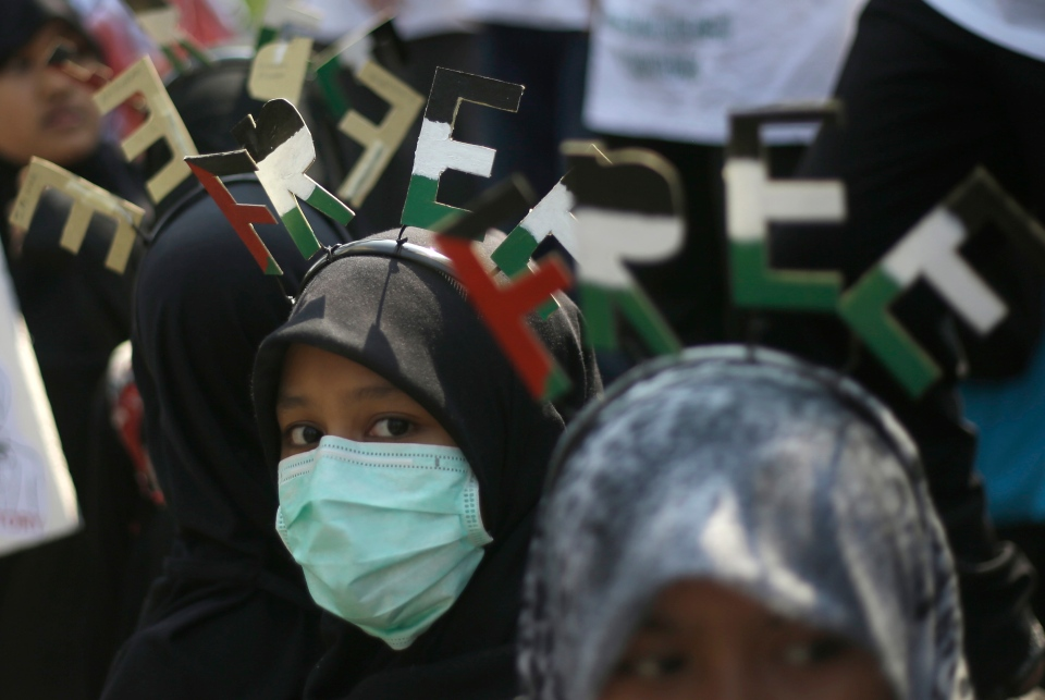 Muslim women take part in an anti-Israel protest marking the International Al-Quds Day outside the U.S. Embassy in Jakarta, Indonesia, Friday, Aug. 2, 2013. (AP / Dita Alangkara)