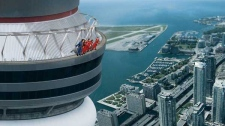 This artist's rendition shows a proposed walkway near the top of the CN Tower in Toronto. As if the view from the top of the CN Tower isn't thrilling enough - people will soon be able to walk around the ledge outside.The famous Toronto landmark is offering a new attraction this summer called EdgeWalk. (Ho / THE CANADIAN PRESS)