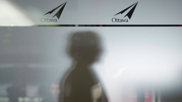 A traveller makes their way through airport security at the Ottawa International Airport in Ottawa on February 3, 2011. (Adrian Wyld / THE CANADIAN PRESS)
